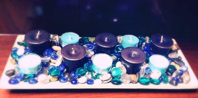 Tray of candles and glass